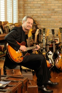 Gary Keller enjoying one of his great pleasures, his guitar collection.